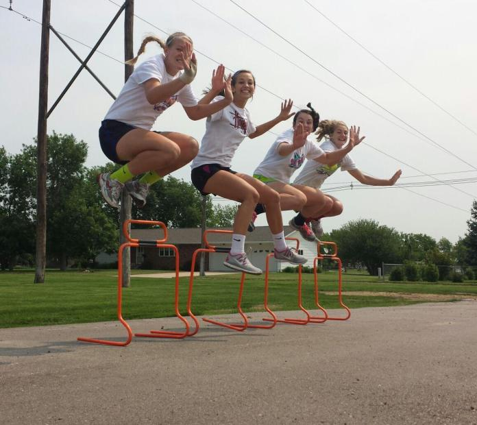 Tracy Chvala, Krissy Krotter, Emily Pongratz and Riley Sibbel with a well timed High 5!
