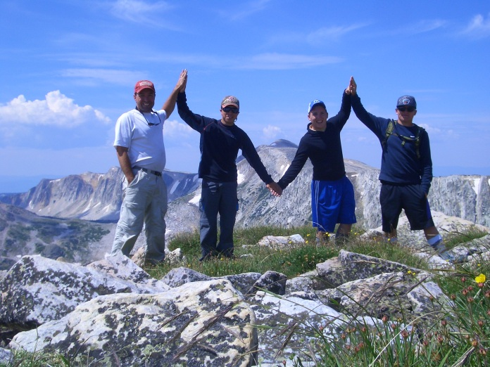 Tim and Garrett Gleason, Ty and Tanner Sawyer in the Snowy Mountains in Wyoming with a high High 5!