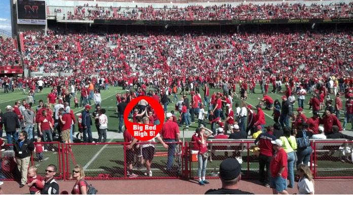 Michael Poese & his cousin Kristin Williams on the turf in a sea of red.
