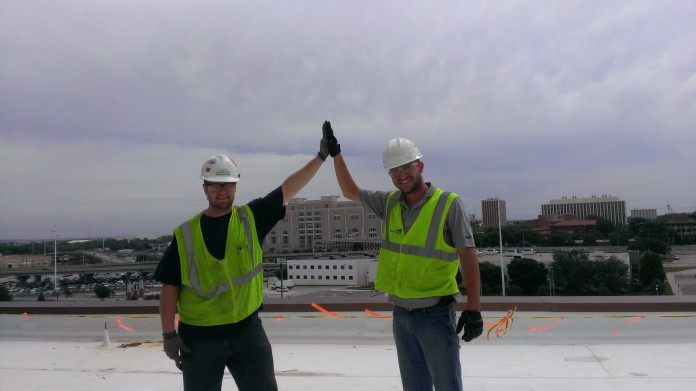 Michael Stepp and Tim Estudillo on the roof at the Pinnacle Bank Arena in Lincoln.