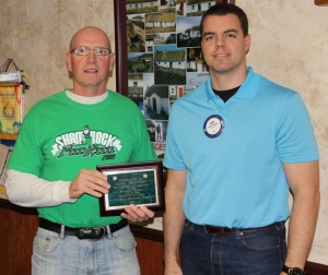 Gary Hostert (left) receives award from O'Neill Rotary President Cody Boettcher