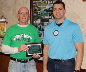 Gary Hostert (left) receives award from O'Neill Rotary President Cody Boettcher