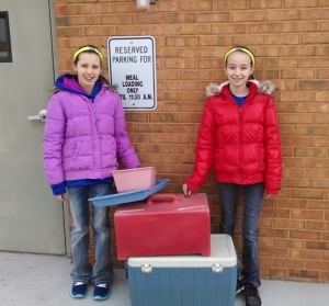 Makayla Hilker (left) and MaKenzie Parks volunteered to deliver Meals On Wheels