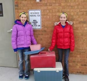 Makayla Hilker (left) and MaKenzie Parks volunteered to deliver Meals On Wheels